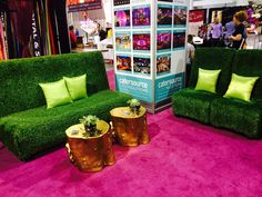 Love these faux grass banquettes with the painted gold stump cocktail tables | AFR Furnishing | Creative event decor