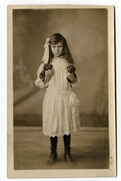 """Pre """"Smile"""" days - Antique Photograph - Little Miss attitude with two sweet puppies."""