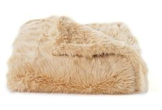 A cozy faux-fur blanket in a timeless camel hue is the perfect fall-ready accent to any cabin bedroom.