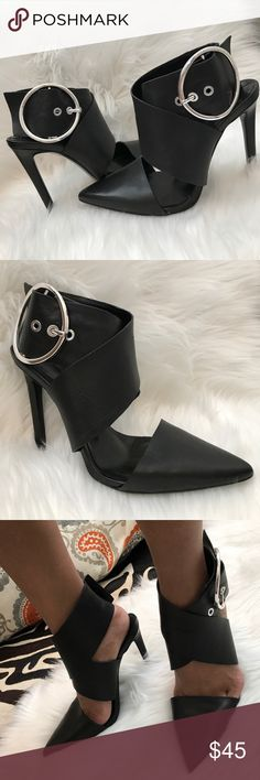 ZARA Black Ankle Wrap Strappy Buckle Heels Ooooolala !! Sexy Zara black leather ankle wrap heels. Wide black ankle straps close with a big silver round buckle on the side. So cute with ripped jeans and your favorite boho top. Add some sexy to your little black dress. These run small due to the pointed toe. They are marked as size 8. Could easily fit a size 7 as well. Gently worn. In great condition. Zara Shoes Heels