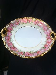 Vintage-Limoges-J-Pouyat-10-5-Hand-Painted-Pink-Roses-Gold-Trim-Handled-Plate  via ebay