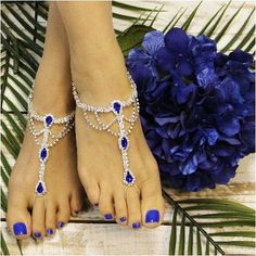 Sapphire blue barefoot sandals, the perfect royal blue foot jewelry for your wedding. Elegant sapphire blue jewels and silver rhinestone barefoot sandals for your dream beach wedding. Our sapphire blu