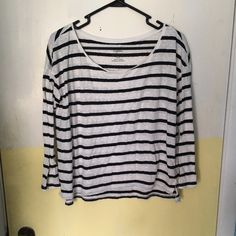 Striped American eagle top Black and white striped American eagle top, size medium!   No holes or stains. No trades. Bundle for discounts!  Or shoot me an offer!! American Eagle Outfitters Tops Blouses