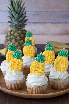 Pineapple Cupcakes - crushed pineapple in the batter and in the frosting! Top them with pineapple cookies or pineapple slices!