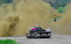 GREAT MILITARY ACTION PICTURES - TANK AMONG EXPLODING BOMBS IN LIVE FIRE EXERCISE - WOW!