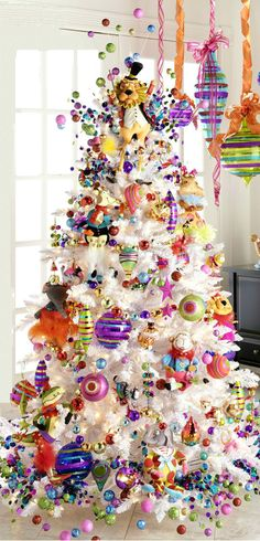 colorful ornaments on a white Christmas tree