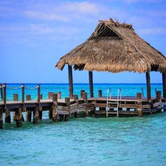 The dock and palapa in front of Secrets resort and the beautiful Caribbean Sea beyond in #Cozumel.