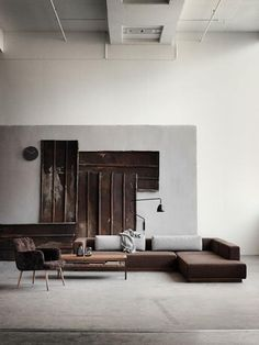 interesting use of metal pieces, low sofa is cool. love the lamp