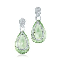 Green beryl and diamond earrings from the Kwiat Legacy Collection A unique pair of faceted green beryls weighing over 25.00 carats each float between the simplistic pave diamond lines.