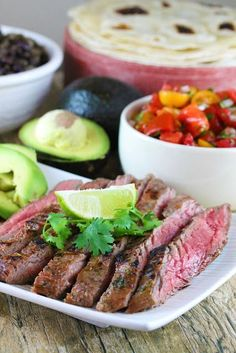 Marinated flank steak is grilled to perfection for the best Authentic Carne Asada. This tender, grilled meat is full of authentic Mexican flavor.