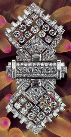 A rare and important Art Deco diamond brooch, by Mauboussin, circa 1930. Designed as a stylised bowtie, set throughout with round and baguette diamonds, signed and numbered. Separates into three to form a double-clip and a brooch. #Mauboussin #ArtDeco #brooch