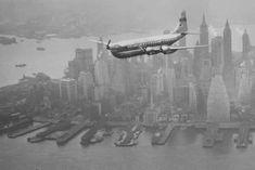 A Boeing Stratocruiser flies low over Manhattan, 1949.