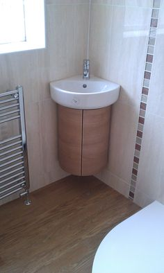 Corner Bathroom Sinks Furniture Modern White Porcelain Corner Sink With Half Round Maple Soap Cabinet And Stainless Towel Hanger Also Wooden Pattern Of Ceramic Bathroom Wall And Floor 29 Marvelous Corner Sink Picture Ideas