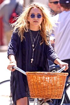 Mary Kate Olsen sunglasses, silver chains and crucifix