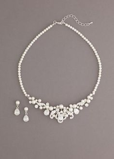 """This gorgeous necklace set will make you look absolutely stunning on your special day!  Pearl set is accented with mix of oval shaped crystals.  Perfect for any bride on her special day - a great update to a traditional look.  Necklace measures approx. 15""""L + 2-1/2"""" extender.  Earrings measure 3/4"""" and secure to ear with a post and clutch closure.  Imported.  Available in Silver."""
