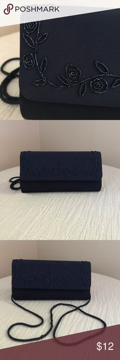 "🎗 Retro Navy Evening Bag Lovely vintage evening bag. Satiny exterior with intricate beading. Measures 9""'wide and 5"" tall. Use with or without strap (tucks inside). Bundle and save! Smoke free home. Bags Clutches & Wristlets"