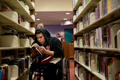 Luis Palaguachi, 15, is among young library patrons who have taken advantage of a program in Queens that allows users to eliminate fines for overdue books by reading in library branches.