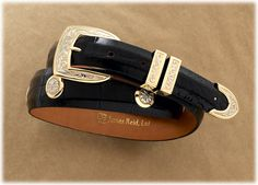 """James Reid, Ltd. - Bolero Concho  Gentleman's through the loops style belt buckle set with studs, mounted on American alligator belt or teju lizard 14kt Yellow Gold and White Gold Buckle, Keeper and Tip with 8 Conchos on Alligator Belt  BP252WN 1"""" <1 1/4"""" Tapered $9,800.00"""
