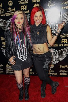 LOS ANGELES, CA - JANUARY 19: Members of Cherri Bomb bassist Rena Lovelis (L) and drummer Nia Lovelis arrive at the Guitar Center's Drum-Off Grand Finals event held at Club Nokia on January 19, 2013 in Los Angeles, California.  (© Paul A. Hebert / www.PaulHebertPhoto.com) *** Local Caption *** Nia Lovelis; Rena Lovelis