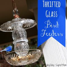 Thrifted Glass Bird Feeders.. With as many bird feeders that we have, I'm going to start doing this. Love the look!