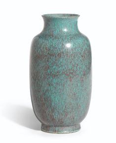 A Robin's Egg Blue Lantern Vase Incised Seal Mark and Period of Yongzheng 700,000 — 900,000 HKD 90,265 - 116,055USD LOT SOLD. 875,000 HKD (112,831 USD)