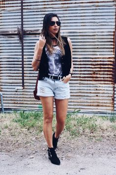 edgy fashion with a black fringe vest. light denim shorts, graphic tee and black choker necklace. with black buckle booties.and some black aviators. perfect for a festival! love this outfit!