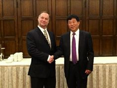Robert #Riola, #CTO of #IneedMD Inc (left) and Zhong Shu Ming, Vice Magistrate of Wuqing District, Tianjin China (right) at the Harvard Club in New York City discussing the expansion of the #EKGGLOVE into China.