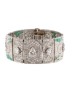 Diamond & Emerald Cuff, Platinum cuff bracelet featuring marquise, rectangular and square cut emeralds with pear and round brilliant cut diamonds throughout. 11.47 ctw diamonds, 2.42 ctw emeralds.