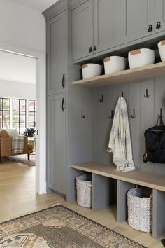 Storage solutions with open cubbies, white storage baskets. Mudroom Cabinets, Mudroom Laundry Room, Laundry Room Design, Bench Mudroom, Mud Room Lockers, Mudroom Cubbies, Ikea Laundry Room Cabinets, Entry Lockers, Closet Mudroom