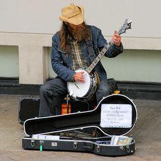 bearded british banjo busker