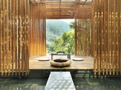 bamboo poles used as permeable screen wall. doesn't have to be over water, but effective enticing visual barrier.