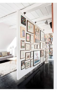 room divider and art display wall. A very smart idea to utilize space