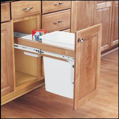 Rev-A-Shelf 4WCTM-12DM1-175 | Made from solid wood (maple) construction, the Top Mount Pullout Waste Containers are designed for absolute sturdiness with front side mounting, rear adjustable mounting brackets for variances in cabinet depth, pre-assembled door mounting brackets and full-extension, ball-bearing, 150 lbs. rated over-travel slides. In addition, the single 35 Qt. waste container system includes a short polymer bin that provides an extra storage space for garbage bags.