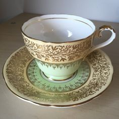 Aynsley Vintage Teacup and Saucer, Light Pastel Mint Green and Pale... ($38) ❤ liked on Polyvore featuring home, kitchen & dining, drinkware, gold tea cup, vintage bone china tea cups, english tea cups, vintage saucer and vintage bone china