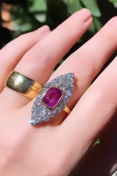 Antique ring with a 3.93 cushion sapphire with GIA stating it is natural, unheated, and Purplish Pink, with 2 old mine cushion-cuts approx. .56 and .48 carat, and about 1.40 carat old European-cut accent. 18k gold and silver. Billings & Sons, Chester of NY, NY. Center: 31 x 14.5mm, band: 2.2mm. Circa 1890
