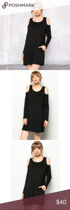 5⭐️ Black Cold Should Cut Out Trapeze Dress 5 ⭐️Review Step out in style chic cutouts highlight your shoulder while pockets add a playful touch to this alluring swing dress. This incredibly comfortable dress is made with soft knit jersey. Made In USA Material: 95% Spandex 5% Ryon No Trades. Price is firm unless bundled. 10% off 2 or more items or 15% 3 or more items. GlamVault Dresses