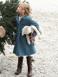 I absolutely love this little girls sweet winter outfit. blue swing jacket and little brown boots.