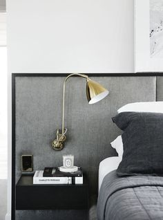Renovation: the overhaul of an art-loving, empty-nester& Melbourne apartment: Lighting plays an important role in this home, with interesting and intricate detailing — including this exposed lamp attached to the bedroom headboard. Stylish Bedroom, Modern Bedroom, Modern Wall, Home Bedroom, Bedroom Decor, Bedroom Lighting, Bedroom Ideas, Apartment Lighting, Bedroom Chandeliers