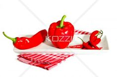 Three Different Red Peppers - A variety of red peppers sitting in a dish on a white background.