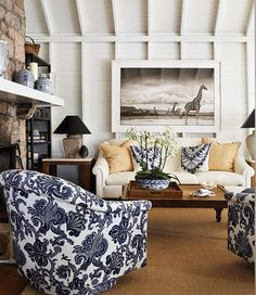 Love the white-washed wooden walls with the chairs in bold print.