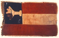 """This flag was dropped by one of Quantrill's Raiders during the Sept 7, 1862 raid on Olathe, KS. The article also calls into question the unsubstantiated stories about the black flag with the misspelled """"QUANTRELL"""" emblazoned across it."""