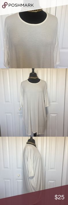 Agnes and Dora tall sheer white hi lo tunic #253 Agnes and Dora 3/4 sleeve Hi Low tunic. Is oversized with a drop shoulder design. Lower part of sleeve is fitted. Measurements taken flat and in inches. Shoulder to shoulder: 24. sleeve: 8 armpit to armpit: 231/2. front center to hem: 26. back center to hem: 331/4. other: tall sizing can also be a short dress for shorter people. Fabric is ribbed and see thru. Agnes & Dora Tops Tunics