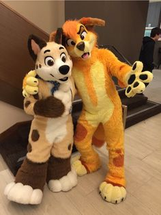 This time @BarleyMutt and @Sunny_Dingo at #FC2016 for #FursuitFriday :)