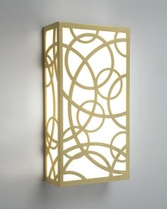 Boyd Lighting's Circolo Sconce was designed by Doyle Crosby. The overlapping circular pattern is made from eighth-inch thick solid brass and seamlessly welded by our craftsmen here in America. ADA compliant. Dimmable. Available in four metal finish options. Style: transitional, contemporary