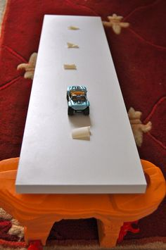 """""""How fast or slow?"""" - Car ramp  (can do it with his Trains, too) with various materials tested on it (bubble wrap, fabric, sandpaper, masking tape, etc) -- cute science activity for Transportation week"""