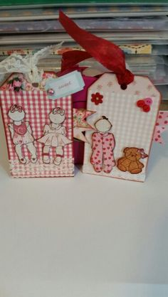 Julie Nutting baby doll tags.