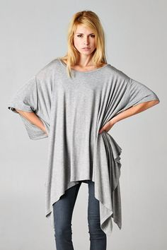 T12890 dolman poncho in rayon span. Loose and comfy, it drapes fabulously in all the right places!  Available in Heather Gray, Black, and White