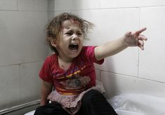 A Palestinian child, al-Shifa hospital after Israeli forces shelled her home in Gaza City by Mohammed Abed