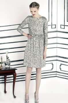 Silver sequined dress & shoes which I would pair w/ black legging/tights & a black belt. Definitely my New Years Outfit!!
