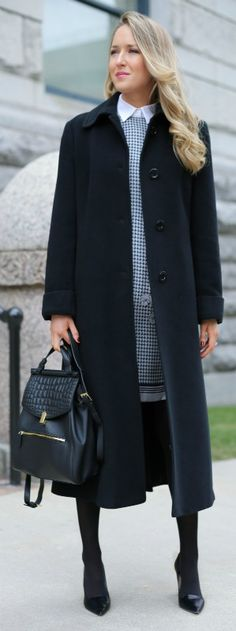 grey printed short sleeve silk sheath dress, layered white collared button down shirt, black tights + black wool maxi coat